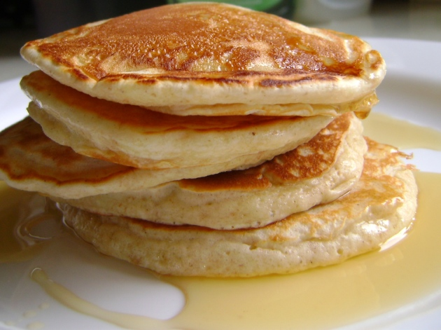 Buttermilk pancakes with butter and fresh maple syrup