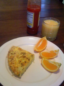 Spanish Frittata with orange slices, juice and hot sauce