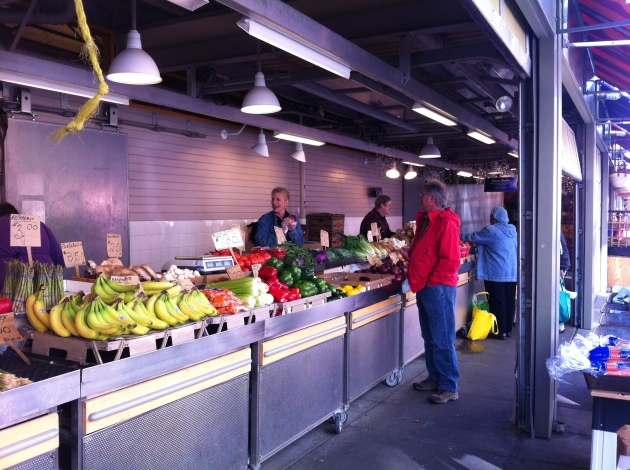 Shoppers selecting produce