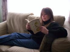 Heather reading Five Quarters of the Orange
