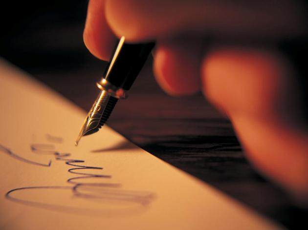 Writing a letter with a pen