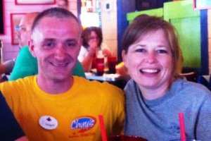 Heather with Devon the waiter at Chuy's