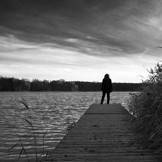 Woman, Sunset, Sea and Silence