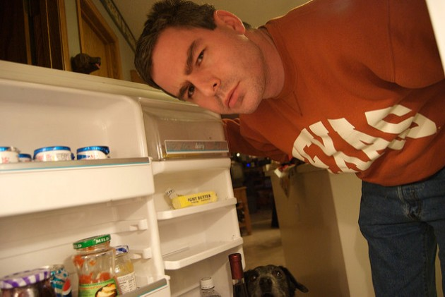 Man looking into refrigerator for a midnight snack