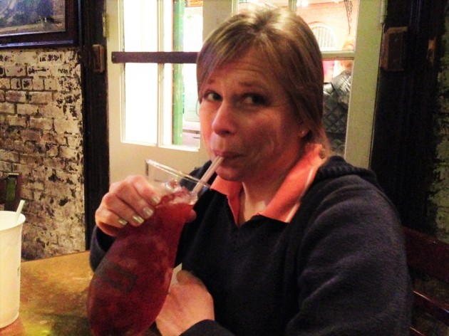 Heather drinks a Hurricane at Pat O'Brien's