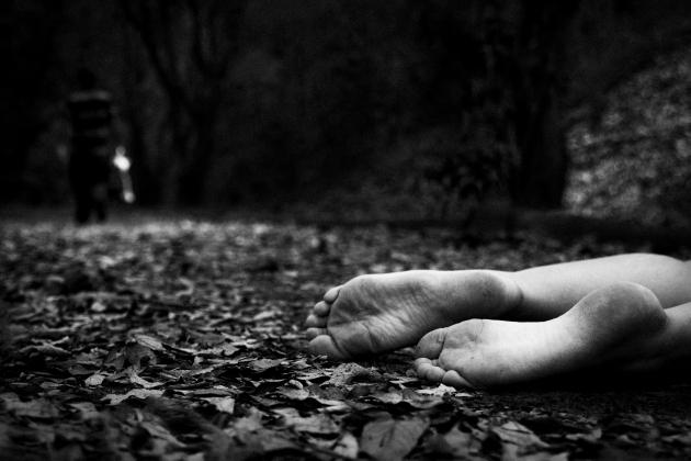 Dead woman in woods