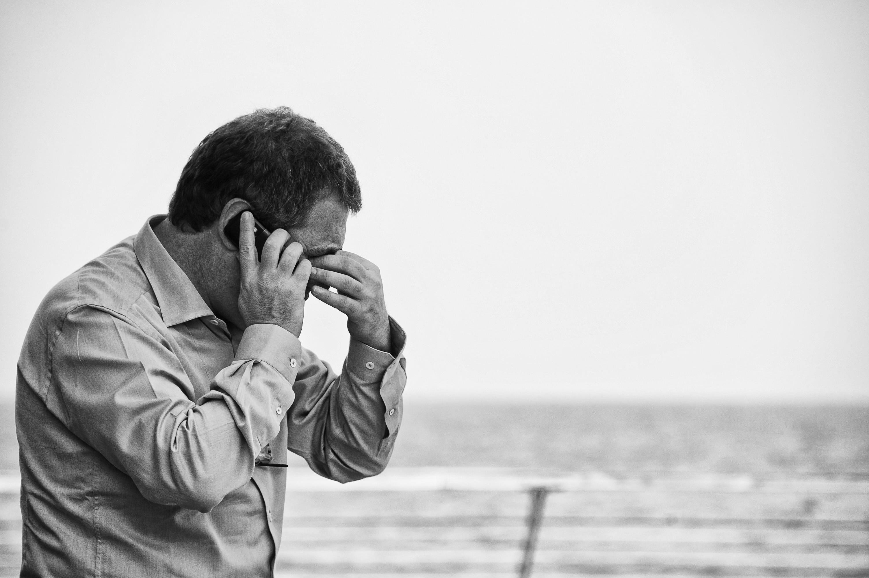 Worried man on phone