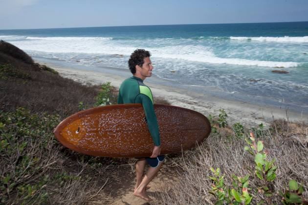 Jaimal Yogis with surfboard