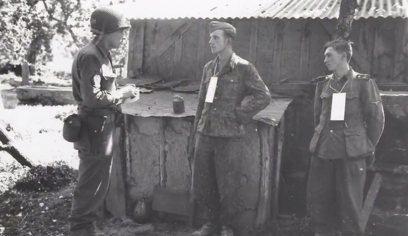 Martin Selling questions German SS captives near the front in France, 1944
