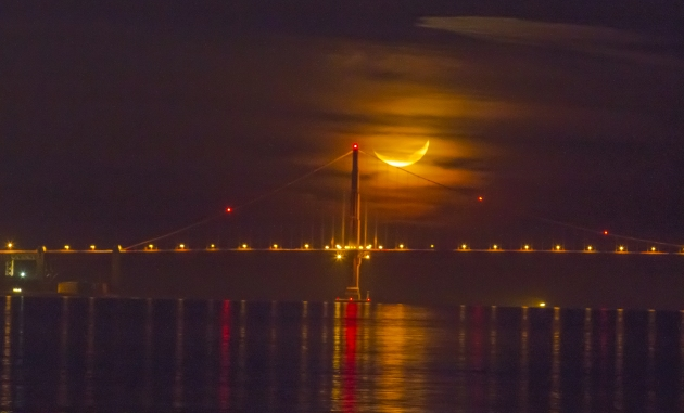 Crescent moon over Golden Gate Bridge