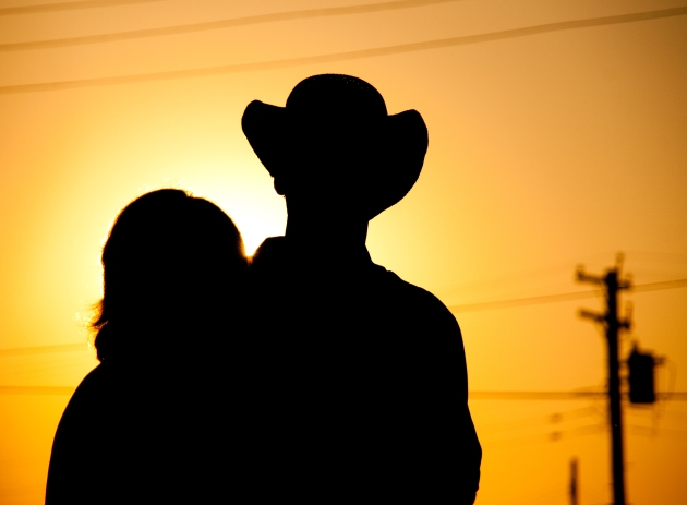 Cowboy and his girl at sunset