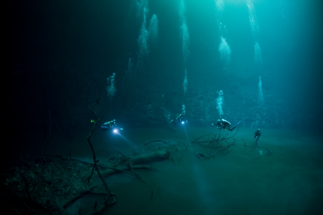 Divers in an underwater cave