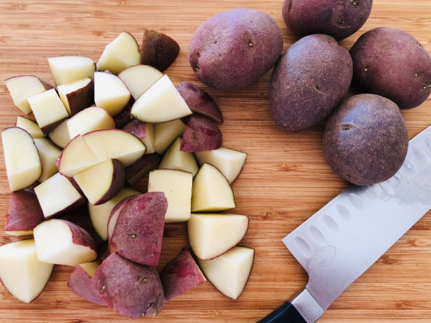 Quartered red potatoes