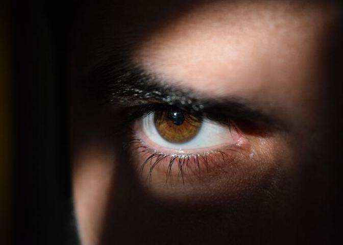 Man's eye in shadow