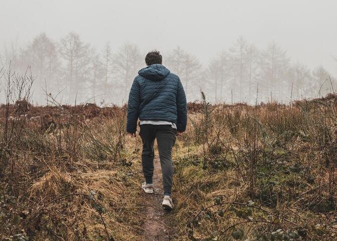 Man walking in meadow