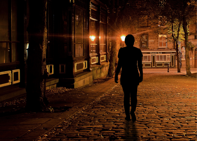Stranger walking in shadows
