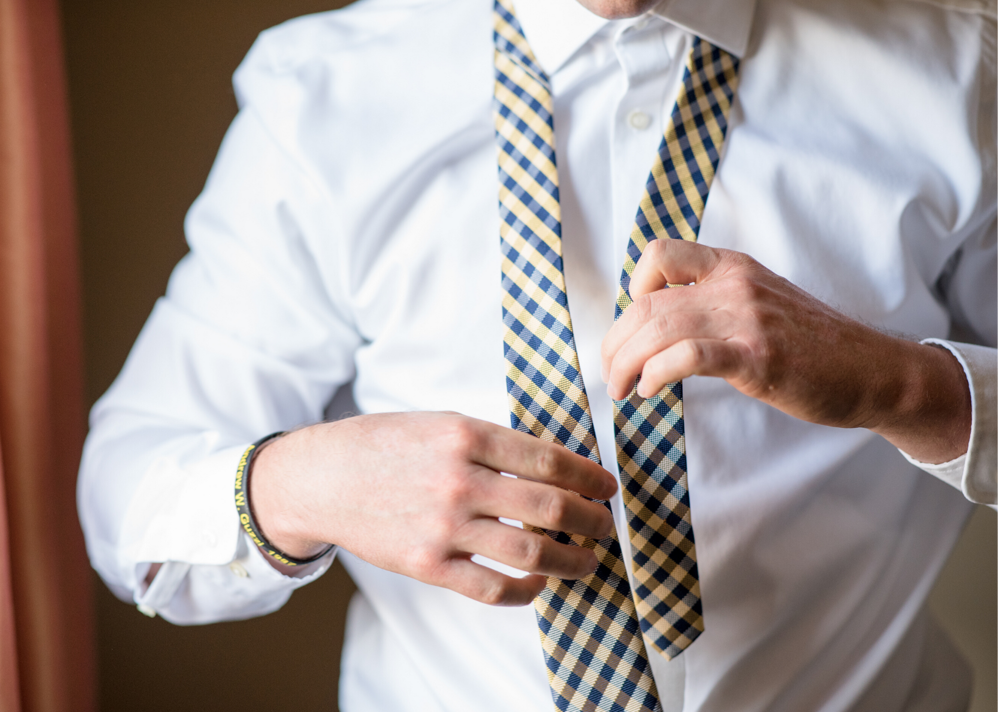 Man putting on a tie