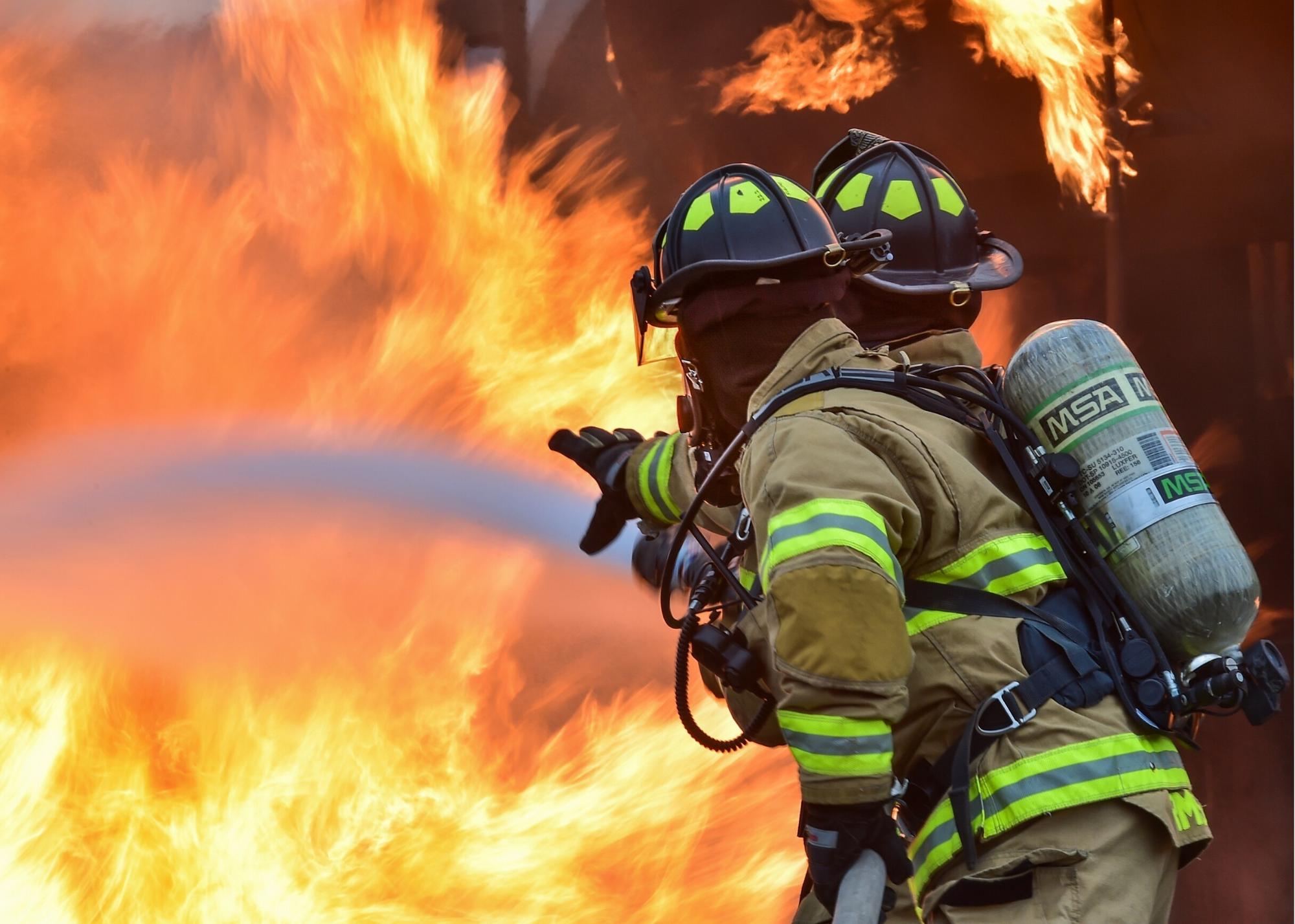 Firemen hosing down a fire