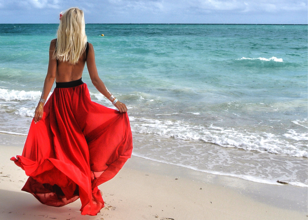 Woman in red dress on beach