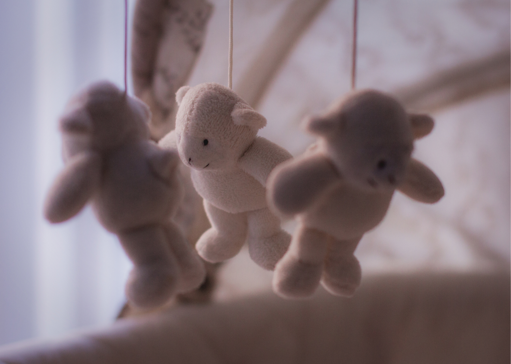 Teddy bear mobile above a crib