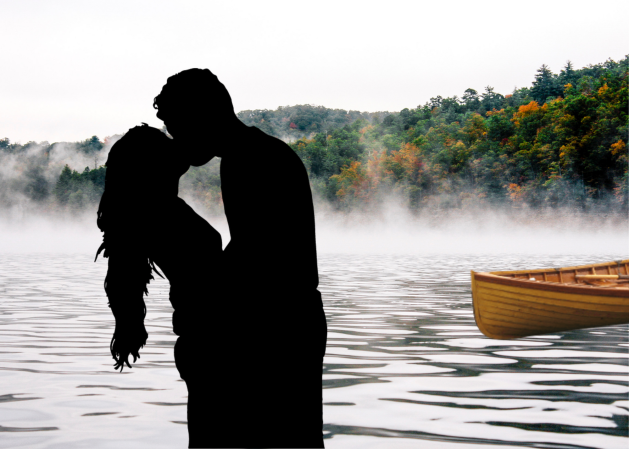 Couple kissing in front of lake